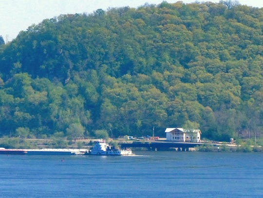 A barge tow moves its cargo down the Mississippi River