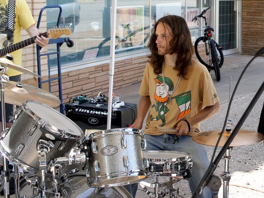 Jacob Tubbs plays the drums Saturday, July 22, 2017, at a monthly Sidewalk Jam/Concert hosted by Bruce Lyons Computers at 914 Scott Ave.