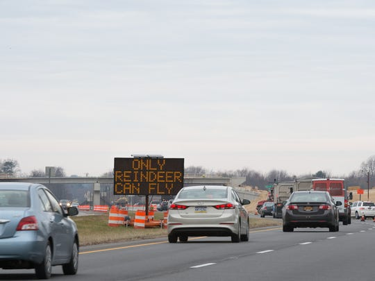 Drivers pass an electronic DelDOT sign, with a reference to reindeer, along Delaware Route 1 in Frederica.