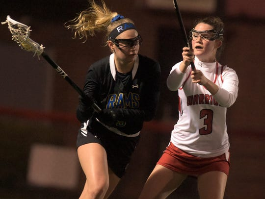 Kennard-Dale's Megan Halczuk handles the ball with pressure from Susquehannock's Riley Roeder during lacrosse action at Susquehannock Tuesday, April 3, 2018. Susquehannock is the No. 1 seed and Kennard-Dale is the No. 2 seed for the York-Adams League playoffs, which start Wednesday. Bill Kalina photo