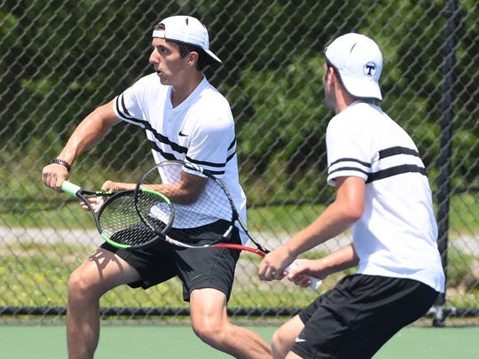 TCA's Ben Sidwell watches as teammate Cam Presley returns a volley during the 2018 Small Division doubles tennis championship in May.