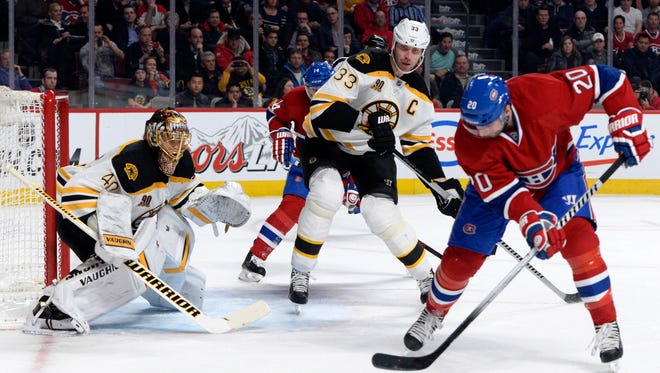 Montreal Canadiens forward Thomas Vanek (20) skates with the puck in front of Boston Bruins goaltender Tuukka Rask (40) and defenseman Zdeno Chara (33) during the second period at the Bell Centre.