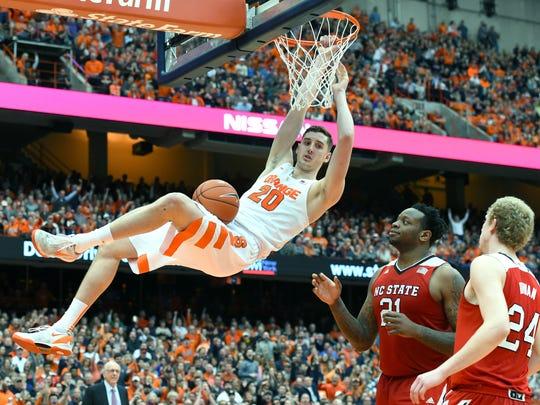 Feb 27, 2016; Syracuse, NY, USA; Syracuse's Tyler Lydon reacts following a dunk in front of North Carolina State's BeeJay Anya, center, and Maverick Rowan on Feb. 27 in Syracuse.