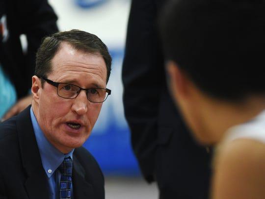 Zanesville coach Scott Aronhat talks to his team during