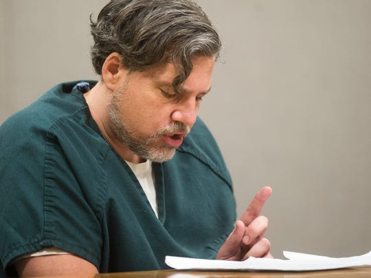 Burlington attempted-murder suspect James Scarola reads from a prepared statement at a hearing at Vermont Superior Court where he tried to fire his public defender Sandra Lee.