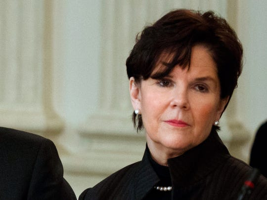 FILE- In this Feb. 23, 2017, file photo, General Dynamics CEO Phebe Novakovic listens as President Donald Trump speaks during a meeting with manufacturing executives at the White House in Washington. At $21.2 million, Novakovic was the fourth highest-paid female CEO for 2017, as calculated by The Associated Press and Equilar, an executive data firm. (AP Photo/Evan Vucci, File)