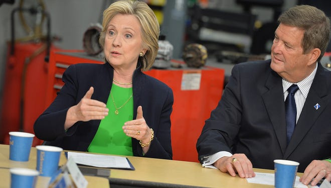 Hillary Clinton and Dr. Mick Starcevich, president of Kirkwood Community College, participate in a roundtable discussion with students and educators during a campaign event in Monticello, Iowa, on Tuesday.