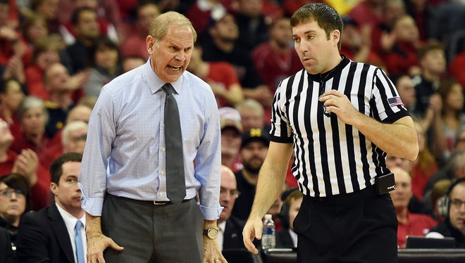 Michigan coach John Beilein reacts to an official's call during a loss to Wisconsin.