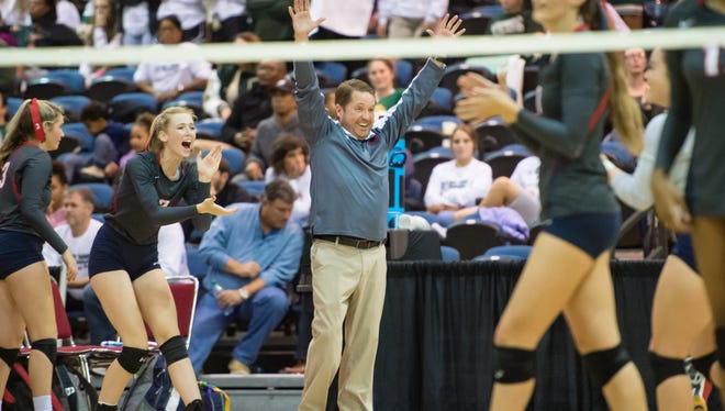 Rebels Head Coach Terry Hebert celebrates the win as the Teurlings Rebels take on St Thomas More during the quarter finals of the  the LHSAA State Volleyball  Tournament at the Ponchartrain Center in Kenner, LA. Thursday, Nov. 9, 2017.