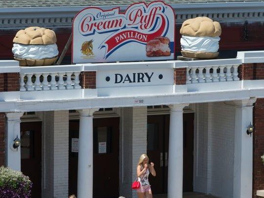 A woman exits the dairy building where cream puffs are made and sold at State Fair Park.