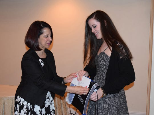 Jennifer Husta, 18, of Mullica Township, a senior at Cedar Creek High School, receives one of the 10th Annual Performing Arts/Education Scholarship Awards from Annette Giaquinto, president of the Atlantic County Association of School Administrators.