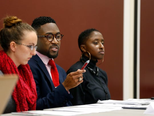 Xavier Torres-Ghoston speaks at a press conference with Shawna Barkley (left), and Ravyn Brooks to outline the reasons they seek the removal of Juan Meraz, the assistant vice president of multicultural services at Missouri State University, on Tuesday, Feb. 2, 2016.