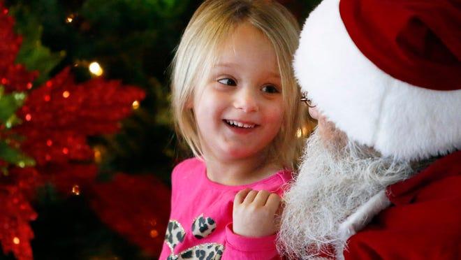 Rylee Rhoden, 4, of Appleton, has a conversation with Santa at a Christmas celebration on Nov. 30 in Grand Chute.