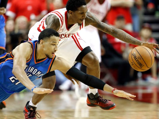 Oklahoma City Thunder's Andre Roberson (21) and Houston Rockets' Lou Williams reach for the ball during the second half in Game 5 of an NBA basketball first-round playoff series, Tuesday, April 25, 2017, in Houston. The Rockets won 105-99 and took the series. (AP Photo/David J. Phillip)