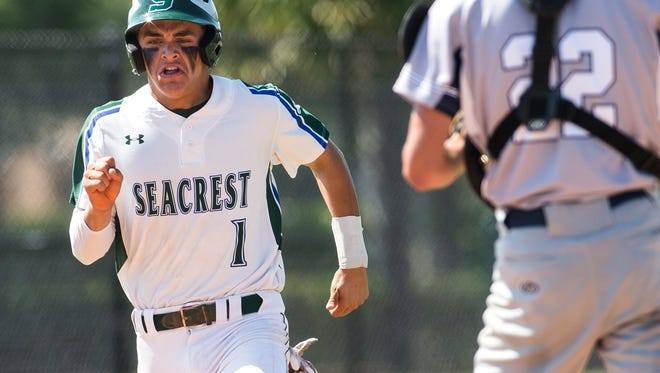 Seacrest Country Day School's Matthew DiNorcia heads towards home plate during a class 2A regional semifinal at Seacrest Country Day School in Naples, Fla., on Wednesday, May 10, 2017.