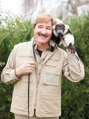 "Peter Gros of ""Wild Kingdom"" with a lemur."