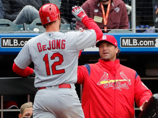 St. Louis Cardinals manager Mike Matheny, right, congratulate St. Louis Cardinals' Paul DeJong (12) after DeJone hit his ssecond home run of the day during the eighth inning of a baseball game against the New York Mets, Sunday, April 1, 2018, in New York. (AP Photo/Kathy Willens)