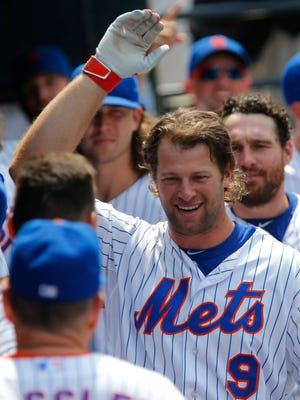 Jul 12, 2015: New York Mets left fielder Kirk Nieuwenhuis (9) smiles after his third home run of the day against the Arizona Diamondbacks  at Citi Field.