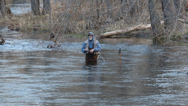 The water was unusually high for opening day like it was here in the Ramapo River section of the Ramapo Valley County Reservation in Mahwah.