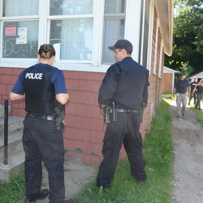 Battle Creek police check a home on Magnolia Avenue Friday afternoon.