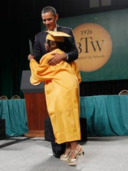 President Barack Obama embraces a graduate after she received her diploma at the Booker T. Washington High School graduation at Cook Convention Center in Memphis, Tenn., Monday, May 16, 2011. (AP Photo/Charles Dharapak)