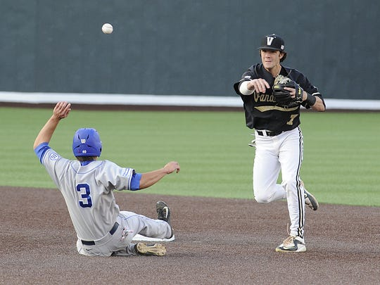 Vanderbilt's Dansby Swanson gets a double play as MTSU's Brad Jarreau slides into second base during a game at Hawkins Field on April 21, 2015.