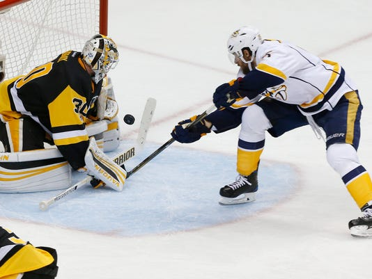 Pittsburgh Penguins goalie Matt Murray, left, stops a point-blank shot by Nashville Predators' Craig Smith during the third period in Game 5 of the NHL hockey Stanley Cup Final, Thursday, June 8, 2017, in Pittsburgh. (AP Photo/Gene J. Puskar)