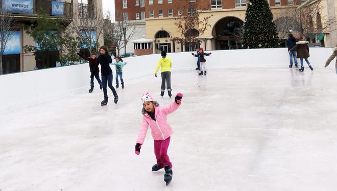 Samantha Menchaca, 6, of El Paso tries on ice skates for the first time at the El Paso WinterFest ice rink in December 2016 at Arts Festival Plaza in Downtown.
