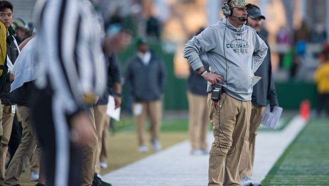"""CSU football coach Mike Bobo watches from the sidelines Nov. 18 as his team takes on San Jose State in the regular-season finale. Bobo will appear on ESPN's """"Coaches Film Room"""" broadcast of the national championship game Monday night, ESPN announced Friday."""