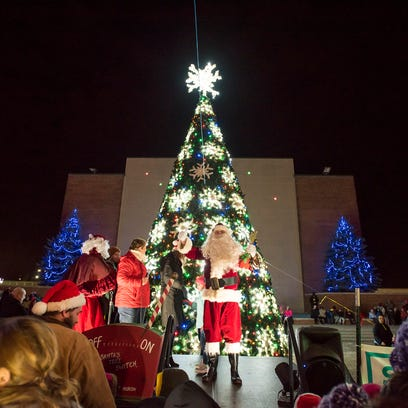 Santa Claus lights the Christmas Tree outside McMorran