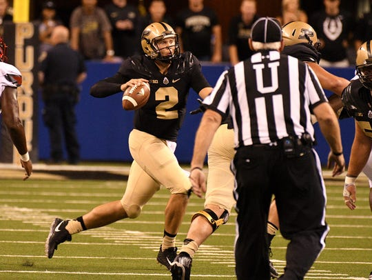 Louisville defeats Purdue 35-28 in Indianapolis on