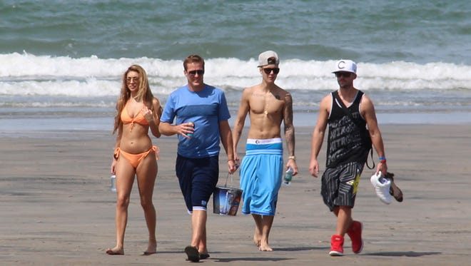 Justin Bieber, second right, and Chantel Jeffries, far left, walk with friends on a Panama beach on Jan. 25.