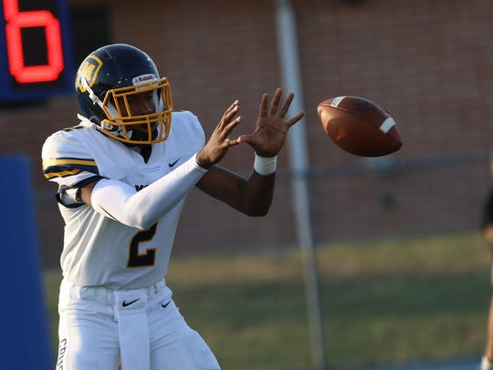 Moeller's Miles McBride takes the snap during the Crusaders