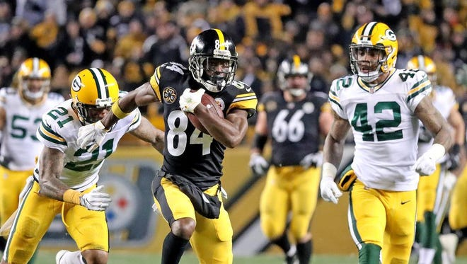 Green Bay Packers free safety Ha Ha Clinton-Dix (21) and strong safety Morgan Burnett (42) chase down Pittsburgh Steelers wide receiver Antonio Brown (84) on a long catch and run at Heinz Field Sunday, November 26, 2017 in Pittsburgh, PA.
