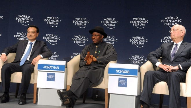 Nigerian President Goodluck Jonathan is flanked by Chinese Premier Li Keqiang and World Economic Forum founder Klaus Schwab during the World Economic Forum in Abuja on May 8.