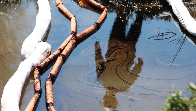 Cleaning up oil in Mayflower, Ark., last year after thousands of barrels of crude oil leaked from a pipeline.