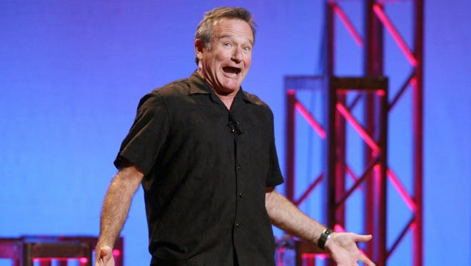 "This Nov. 23, 2009 photo released by Starpix shows actor-comedian Robin Williams performing his stand-up show, ìWeapons of Self Destruction,î at Town Hall in New York. After thousands of fans petitioned the creators of the online role-playing video game ""World of Warcraft"" to memorialize Williams, the game's lead designer said Thursday that Blizzard Entertainment planned to create a character inspired by the actor, comedian and avid gamer, who died Monday, Aug. 11 of an apparent suicide at the age of 63. Williams was a notable fan of the massively multiplayer fantasy game, which is currently played online by about 6.8 million people. (AP Photo/Starpix, Dave Allocca) ORG XMIT: NYET424"