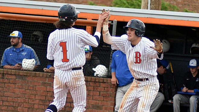 Beech's Sam Ayers meets Ty Sutley (1) at home plate after both runners scored on a fifth-inning double in the Buccaneers' 6-2 victory over Lebanon on Saturday.