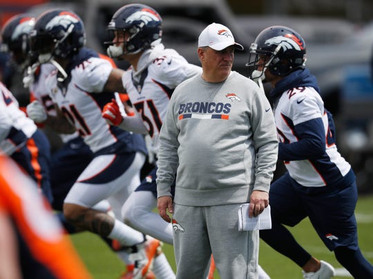 Denver Broncos coach Vic Fangio watches as players take part in drills during the NFL football team's veterans minicamp Tuesday, April 16, 2019, in Englewood, Colo. (AP Photo/David Zalubowski)
