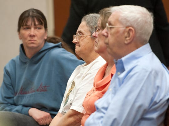 The wife of Kenneth Clark, center, watches as the 71-year-old-man pleaded not guilty in Burlington to one count of second degree attempted murder and to one count of first degree aggravated domestic assault with a weapon at Vermont Superior Court on Friday April 25, 2014.