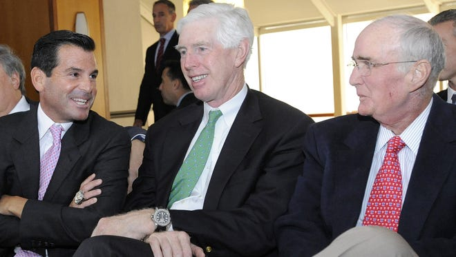 Miami Marlins president David Samson, Atlanta Braves chairman Terry McGuirk and Philadelphia Phillies president David Montgomery chat after team owners elected Major League Baseball Chief Operating Officer Rob Manfred, not pictured, as the next commissioner of Major League Baseball during an owners quarterly meeting in Baltimore Thursday, August 14, 2014.