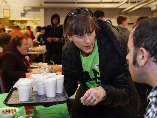 Volunteer Rachel VanDerStuyf of Fishkill hands out