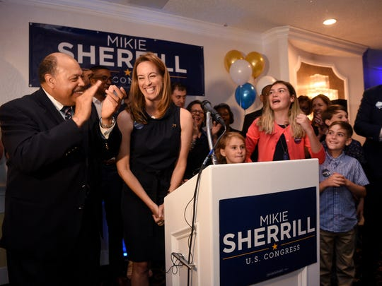 John Currie, the Democratic State Chairman and the longtime Passaic County Democratic Chairman with Mikie Sherrill and family as she celebrates her win in the 11th district NJ congressional democratic primary election with her supporters, campaign volunteers and elected officials at the Richfield Regency in Verona on Tuesday, June 5, 2018.
