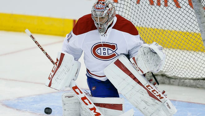 Carey Price makes one of his 36 saves.