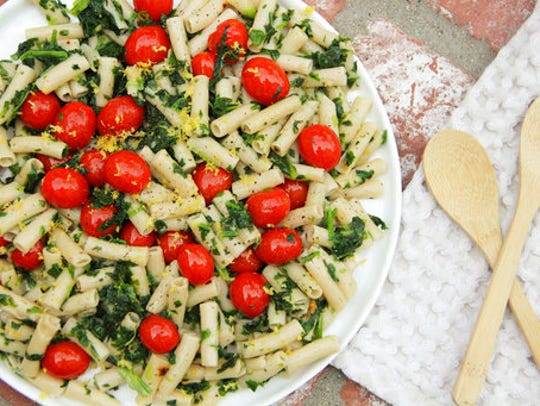 This April 2017 photo shows penne with tomatoes, garlic,