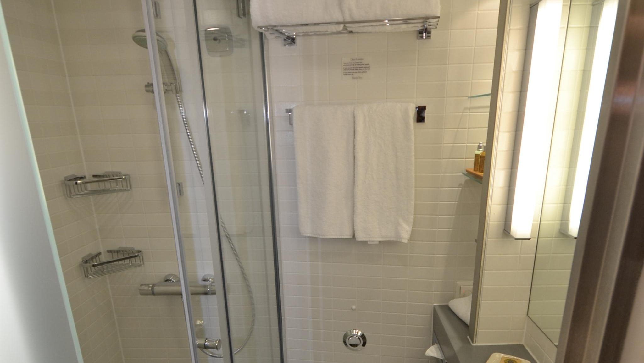 The bathroom in a French Balcony Stateroom. All cabin bathrooms on the Viking Odin feature heated floors and mirrors.