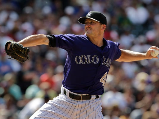 Colorado Rockies pitcher Rex Brothers throws against the Atlanta Braves in the seventh inning of a baseball game in Denver, Saturday, July 11, 2015.(AP Photo/Joe Mahoney)
