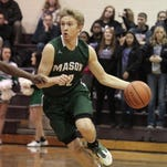 Mason's Matt King sprints out of the backcourt with the ball. The Comets beat the Middies 68-57 on Tuesday.