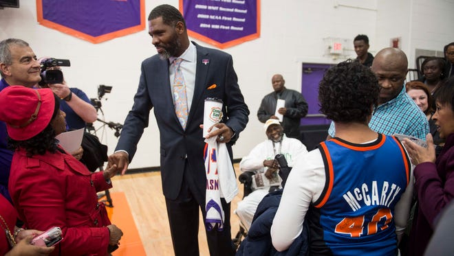 University of Evansville mens basketball head coach Walter McCarty greets fans and friends after being introduced at Meeks Family Fieldhouse on Friday, March 23, 2018. McCarty, an Evansville native was announced as the new University of Evansville mens basketball coach Thursday.