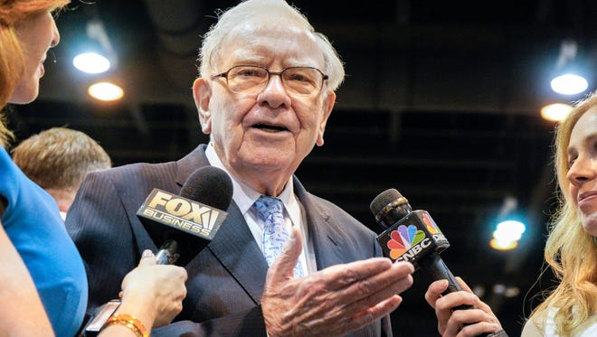 Warren Buffett, Chairman and CEO of Berkshire Hathaway, speaks to reporters during a tour of the exhibit floor at the CenturyLink Center in Omaha, Neb., Saturday, May 5, 2018, where Berkshire brands display their products and services. Tens of thousands of Berkshire Hathaway shareholders have arrived in Omaha for the annual shareholders meeting, where Buffett and his Vice-Chairman Charlie Munger preside over a Q&A session. (AP Photo/Nati Harnik) ORG XMIT: NENH104